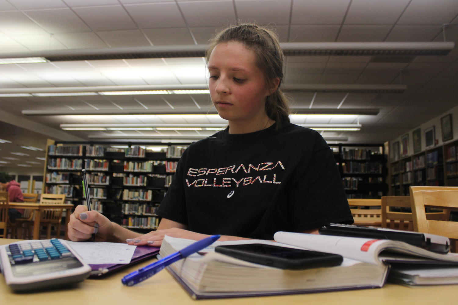 Sophomore Emma Erickson studying in the library.