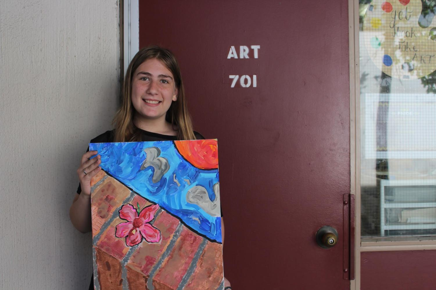 Maddison McDonnell, freshman, holds her winning project on November 8 for the Art Club theme, Impressionism