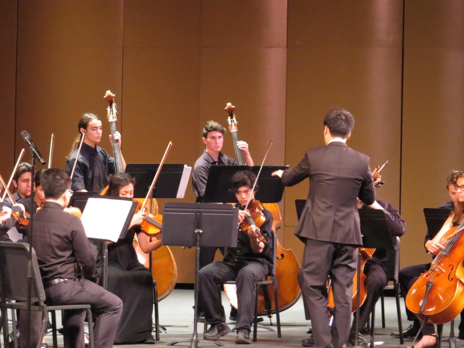 Mr. Fang conducting the Sinfonia Orchestra at the Performing Arts Center for their first concert of the year.