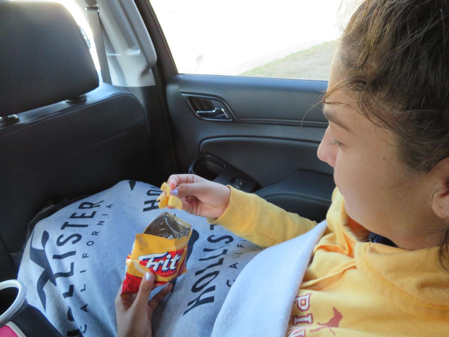 Snacking while during a long car ride is the best thing to do! Maya De La Torre is doing just that for her holiday break.