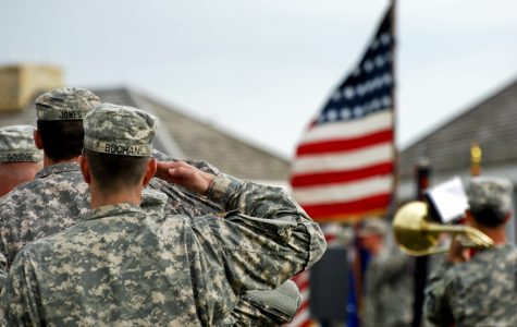Soldiers of 1st Brigade Combat Team, 34th Infantry Division salute the American flag as the United States anthem is being played during their departure ceremony at historic Fort Snelling May 22, 2011. Image from Google Commons.