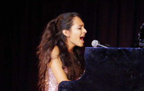 Paloma Cervantes (12) both plays the piano and sings