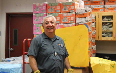 Mr. Gomez, from the transportation unit at Second Harvest, comes to collect cans to bring back to the warehouse.