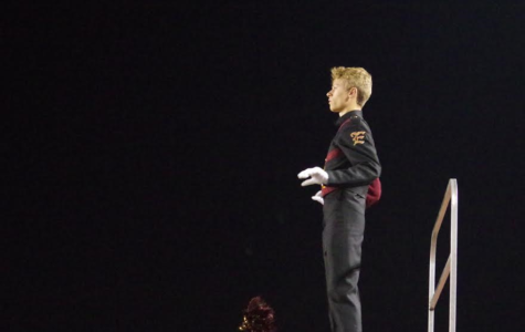Drum Major Cole Wiseman as he begins conducting the performance.