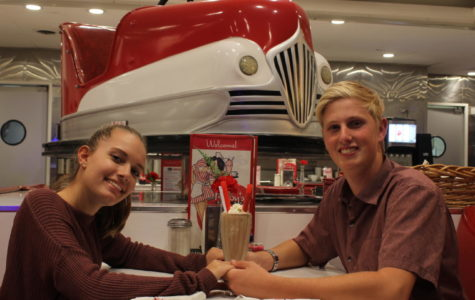 Grace Hiltbrunner-Johnson, sophomore, and Bryn Harper, senior, doing Valentine's Day 50's style by splitting a chocolate shake at Ruby's.