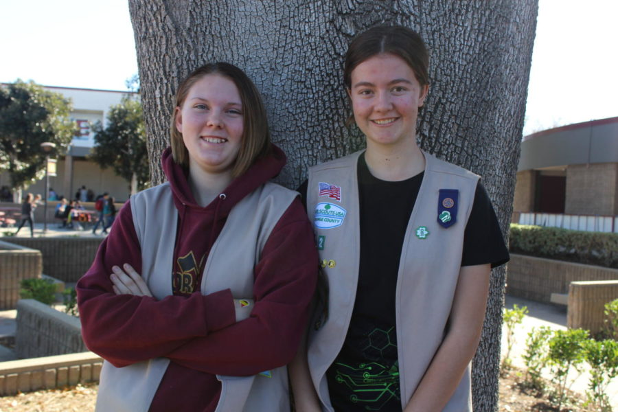 Freshmen Adalantra White and Kylie Toblesky proudly wearing their Girl Scout uniforms.