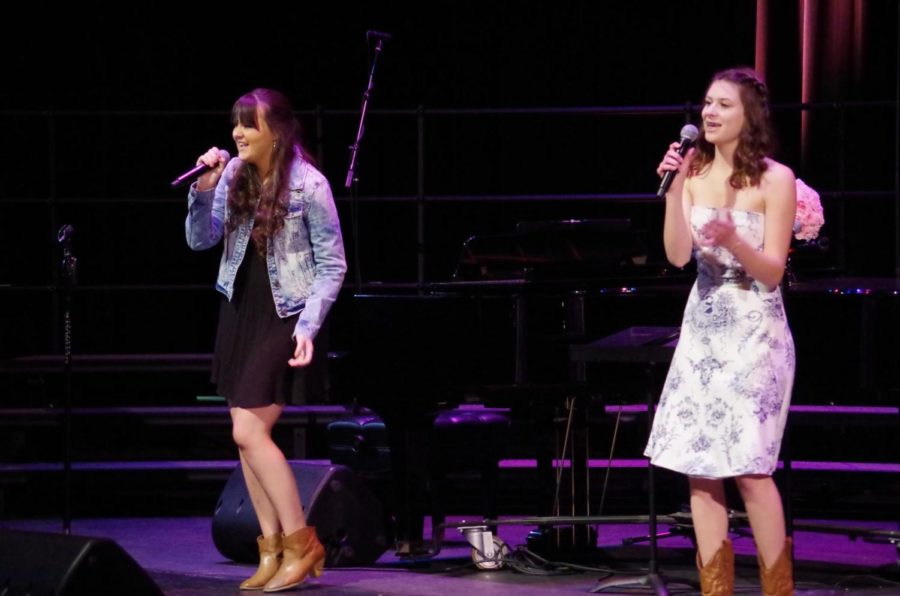 (Left to Right) Kirsten Gue & Lindsay Harris make an excellent duo while singing Shut Up and Fish.
