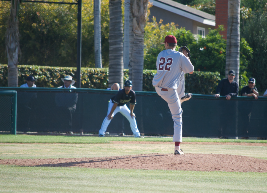 Gavin Lizik winds up to strike out El Dorado baseball player.