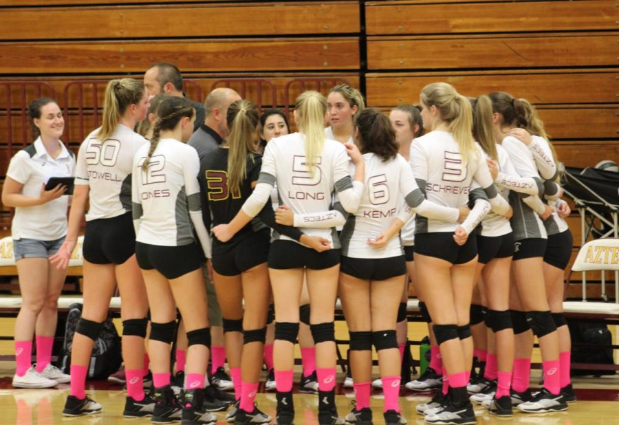 Varsity Women's Volleyball Team during a huddle at their home game on 10/4.