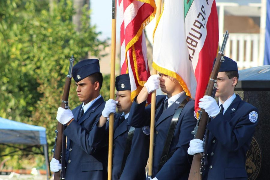 JROTC+cadets+senior+Miles+Duran%2C+senior+Logan+Griffin%2C+junior+Juan+Marquez+Estrella+and+freshman+Ethan+Kadera+at+Veterans+Park+on+Nov.+11.+
