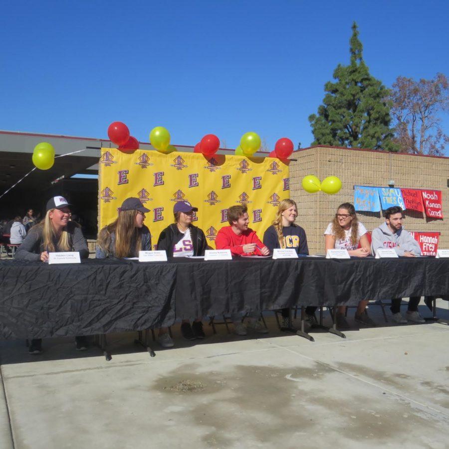 Haiden+Lang%2C+Megan+Nieto%2C+Emma+Robbins%2C+Micheal+Franklyn%2C+Samantha+Fries%2C+Hannah+Frey%2C+and+Noah+Kanan+celebrating+their+signing+day+for+their+athletic+accomplishments.
