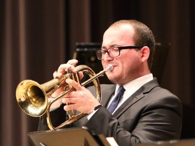 Alumni Ryan DeWeese performing on trumpet at Dizzy's Club Coca-Cola in New York.