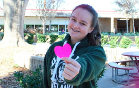 Freshman Meagan Hurley getting ready for some Valentine's Day cheer.