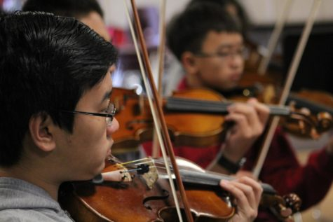 Matthew Lee, sophomore, plays his violin during a song that will be performed at Segerstrom Center on March 9.