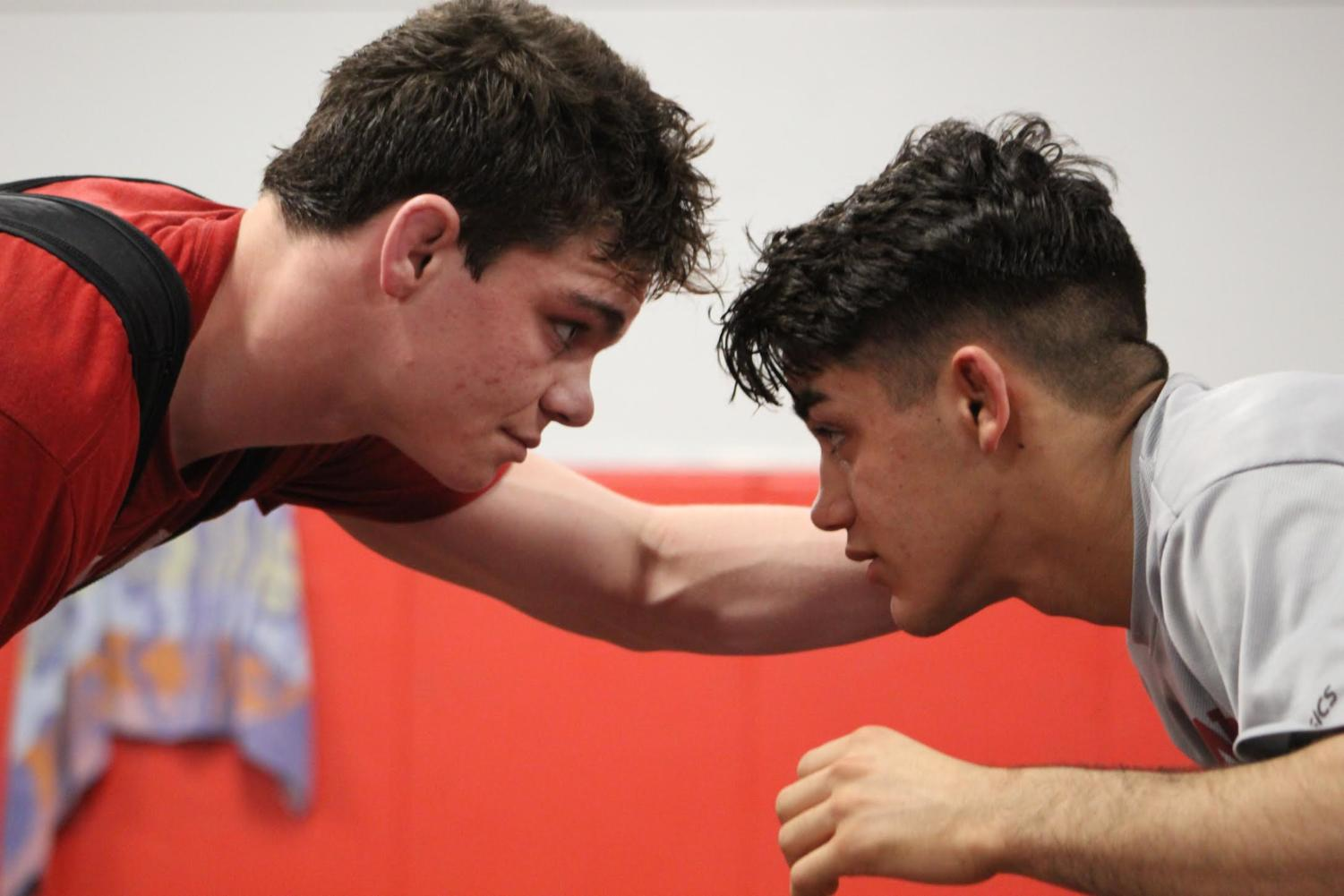 Juniors Joey Mora (left) and Aaron Nagao (right) prep for a practice match on campus.