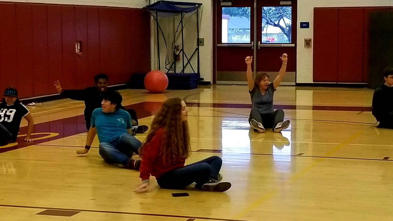 Rachel Williams and Ms.Walters having a great time celebrating a goal during a friendly game of crab soccer with Kaylie Meredith, Xavier Thomas, and Scott Conte.
