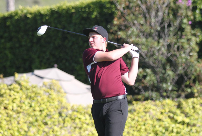 Senior Carson Baehr competing during a golf match.