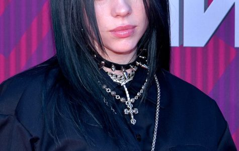 The picture above is of Billie Eilish, a young singer who is known for having a interesting style.