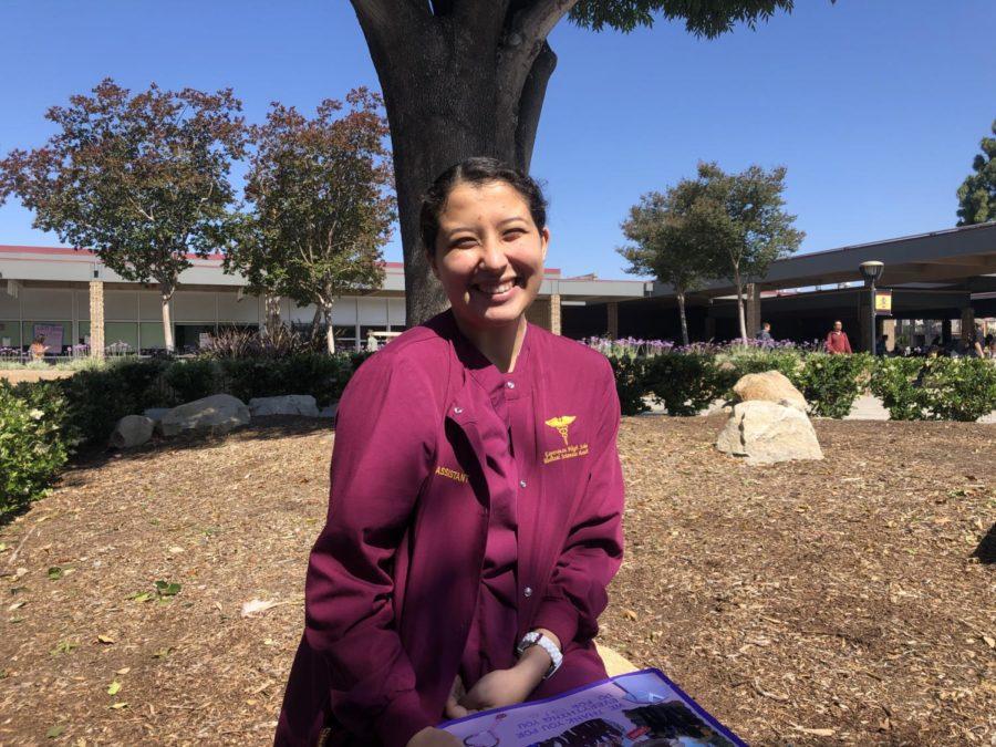 Senior Jocelyn De La Torre wears her scrubs to represent the medical program.