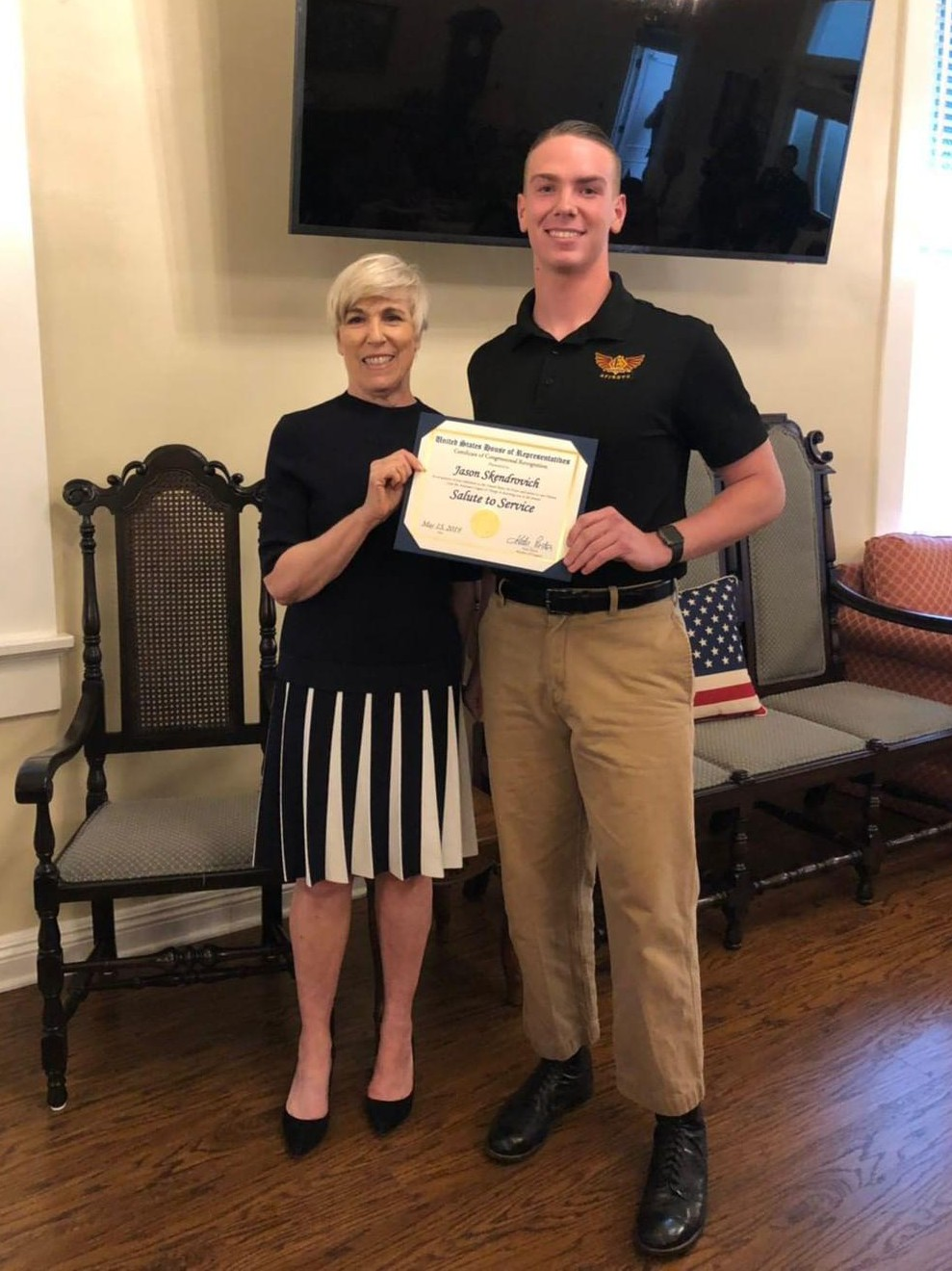 Senior Jason Skendrovich receiving his honorary congressional certificate from the Orange Assistance League at the Salute to Service dinner. The award honors high school enlistees to the military.