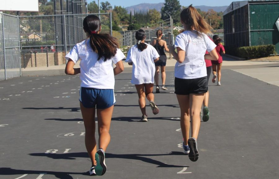 Girls' Varsity Cross Country on their way to the track for practice.
