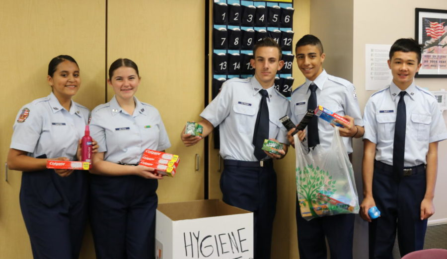 0+period+AFJROTC+class+organizing+a+few+of+the+items+donated+for+the+veterans+drive.