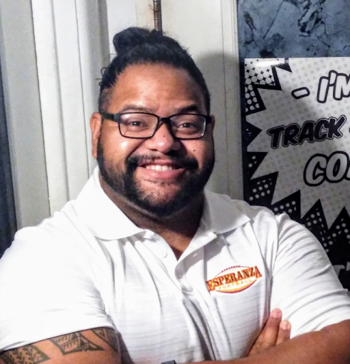 New football and track coach, Carlos Castellanos, is seen with a huge smile and wearing his EHS football merchandise.
