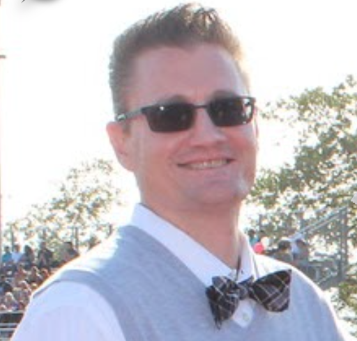 New Engineering and Math teacher, Ryan Durocher, poses with his sunglasses and bow tie on a sunny day.