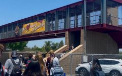"""The giant sign, hanging loosely above the street and hooked into the metal bars, reminds us that we're appreciated because of the words, """"We love our seniors"""" fabricated into it."""